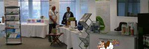 Messestand Heiko Rether im Gespräch mit Kunden 2013 Grünauer Tagung